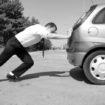 Guy Pushing Car