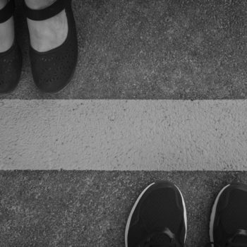 Legs of a couple standing opposite each other